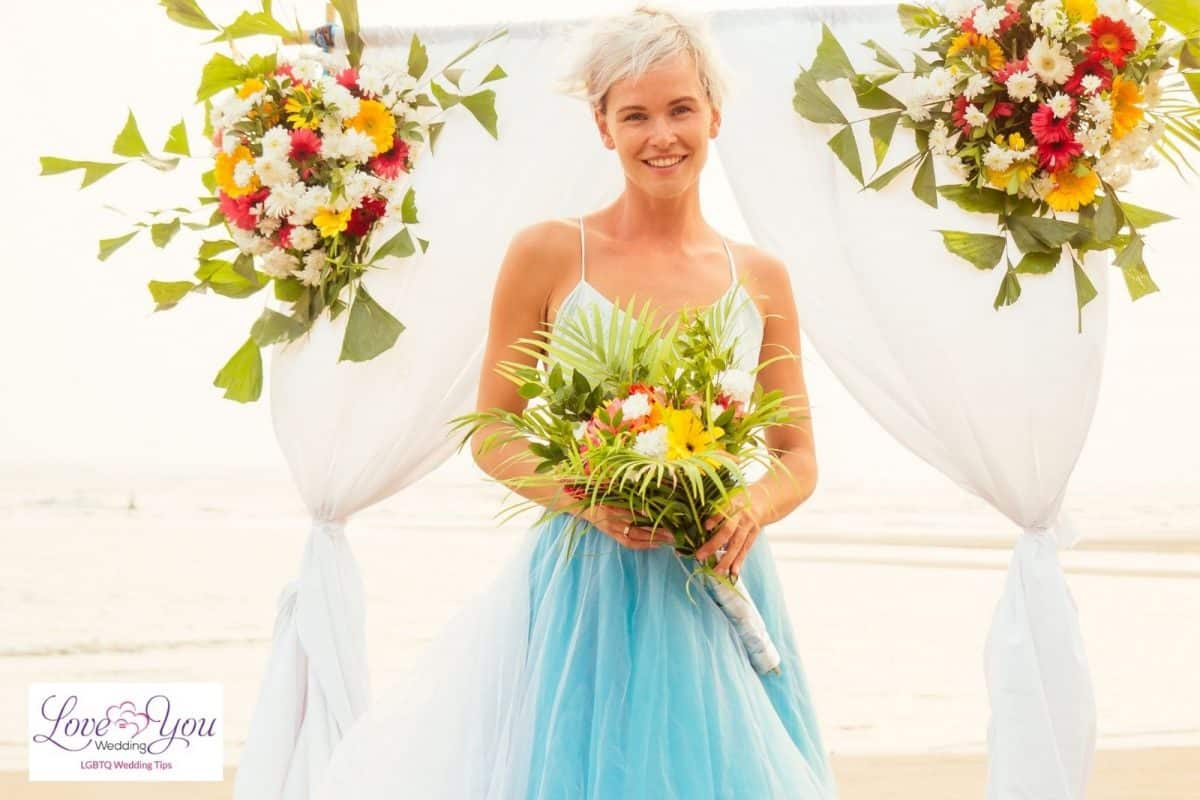 beautiful short-haired bride holding flowers