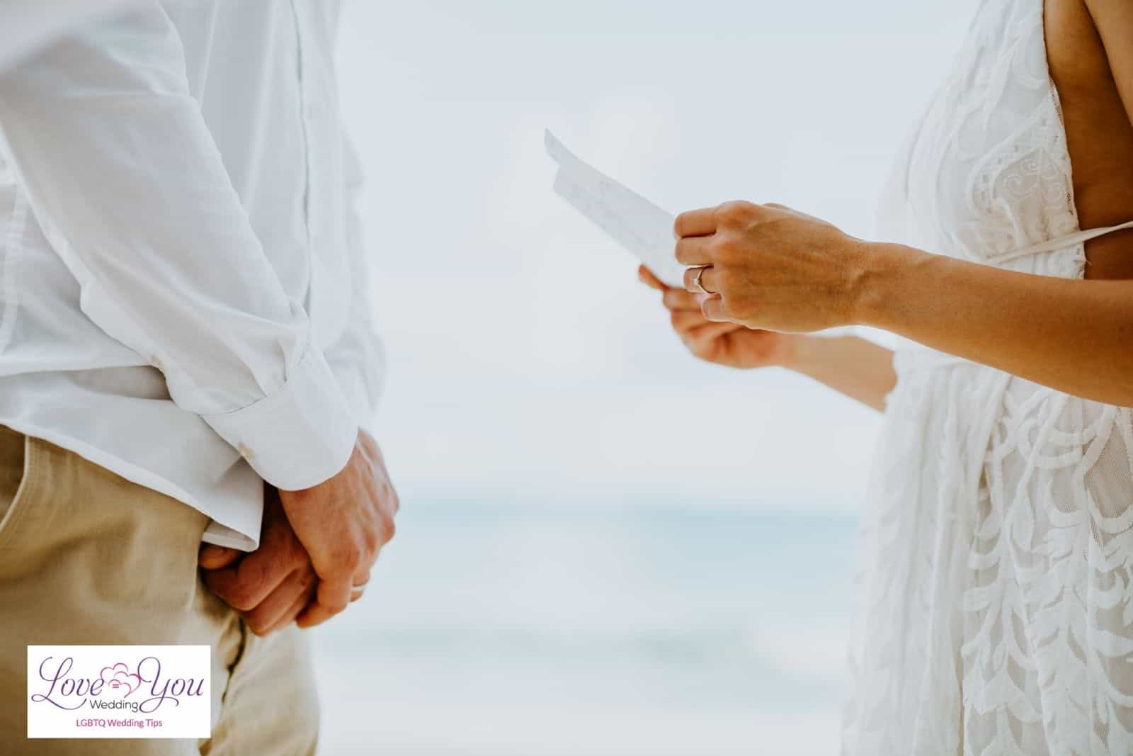 bride holding a paper with wedding vow songs