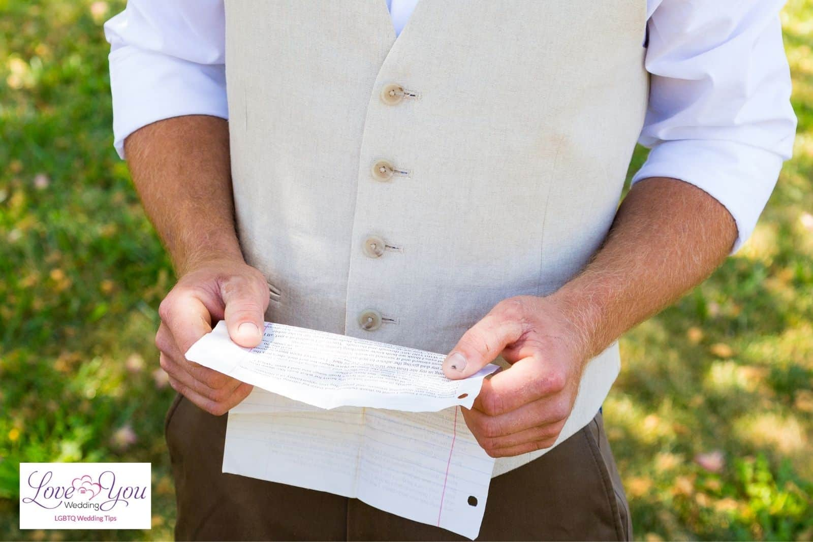 man holding a paper containing his wedding vows