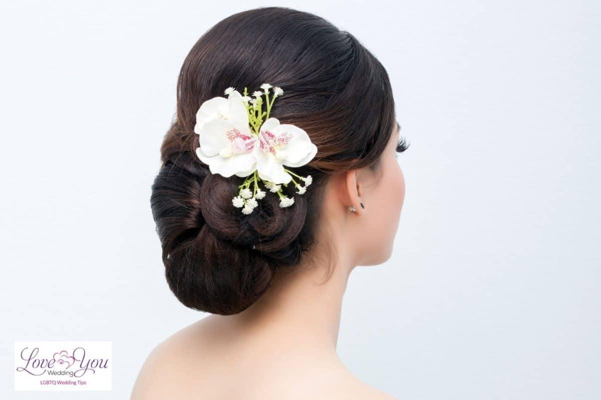 bridal hair neat bun with white flower