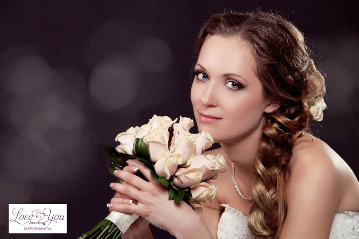 bride with side fishtail hair
