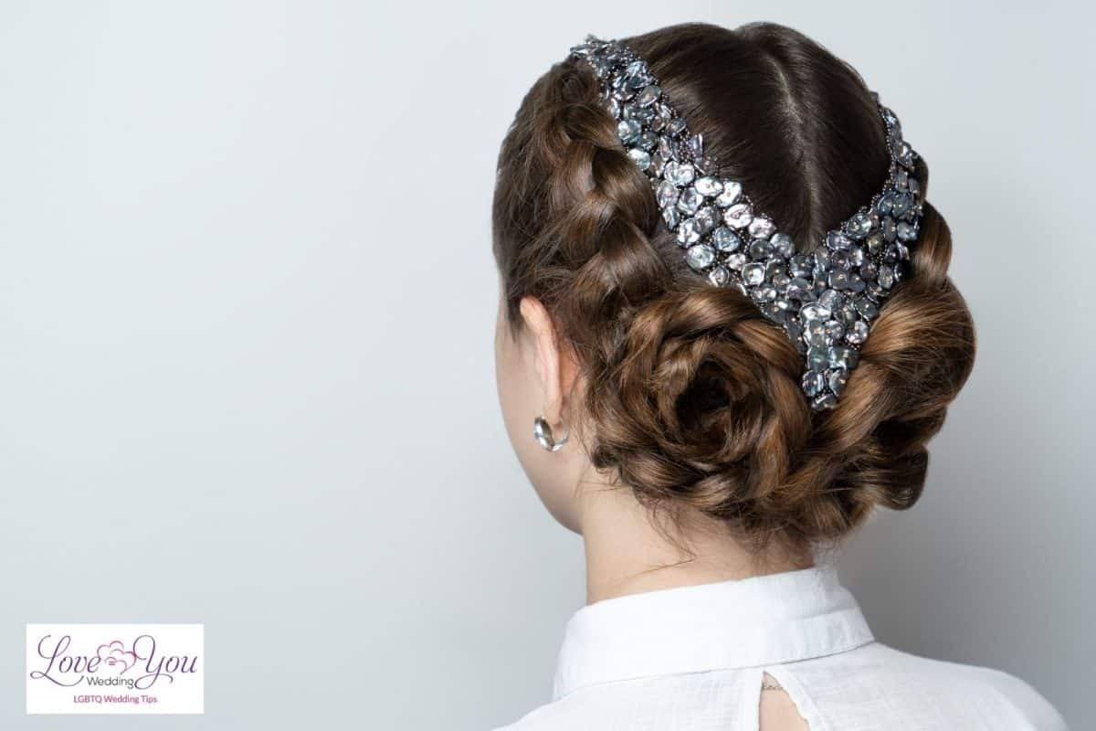 bride with rose bun and jewelry